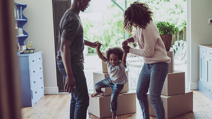 Family and moving boxes
