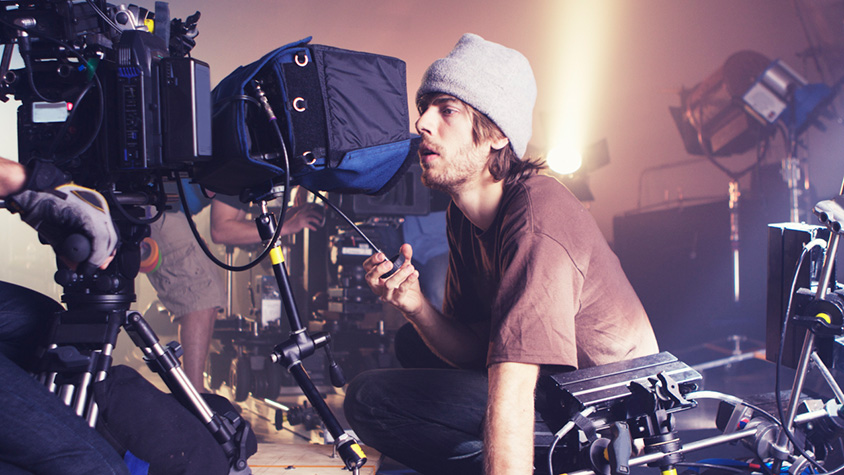 man behind a movie camera