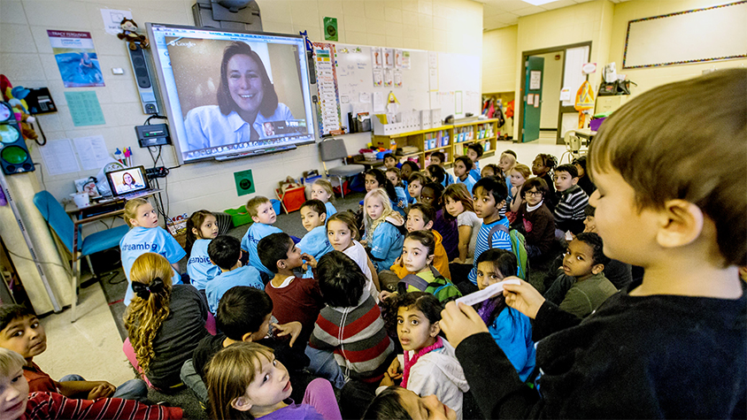 Students meet with an athlete through a video connection