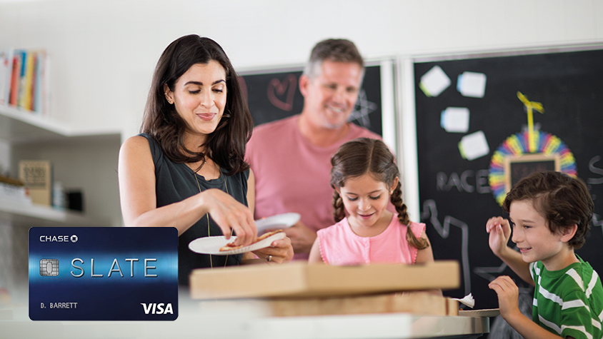 Chase Slate card overlay on image with young children and parents having pizza