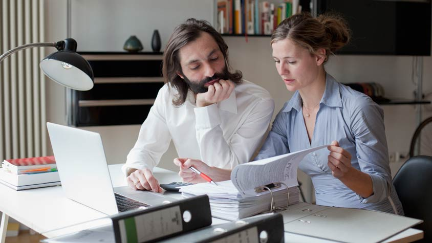 Couple reviewing financial records