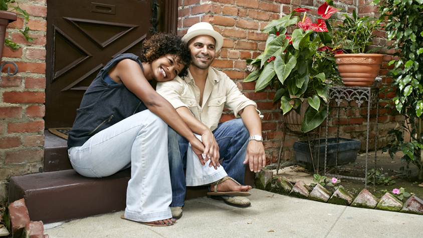 Couple sitting on a doorstep