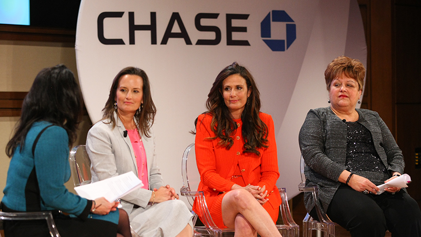 Women speaking at panel event