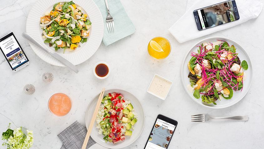 Food and phones on table