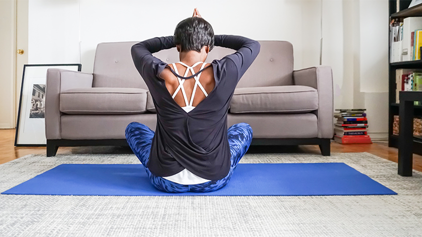 African American woman doing yoga at home.