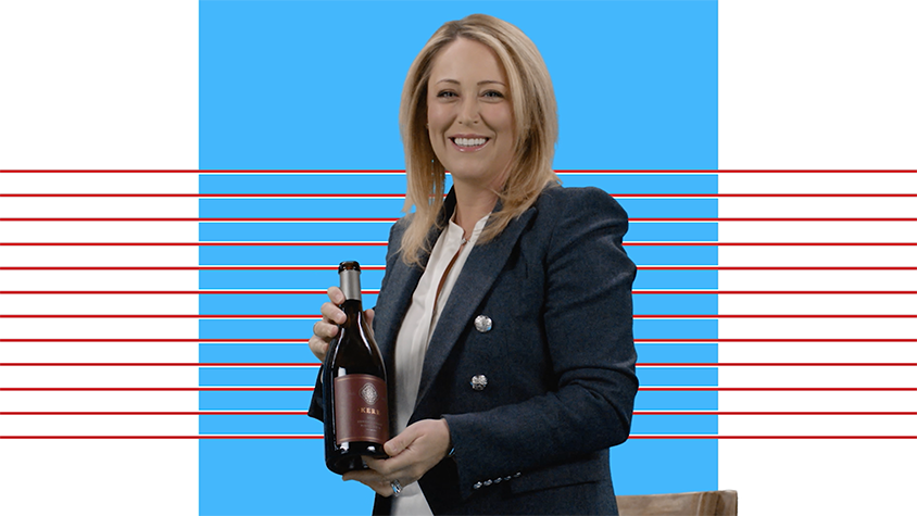 Christie Kerr holds a bottle of her own brand of wine.