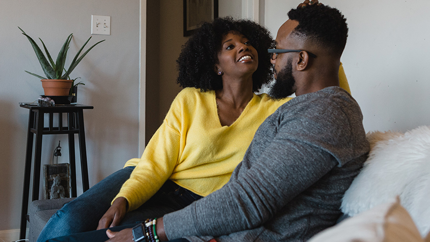 Tonya Rapley and her husband on sofa in their house