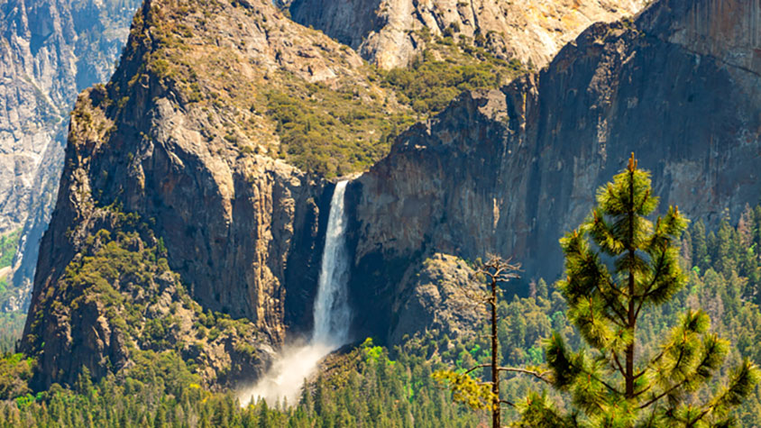 Photo of a waterfall flowing in Yosemite National Park.