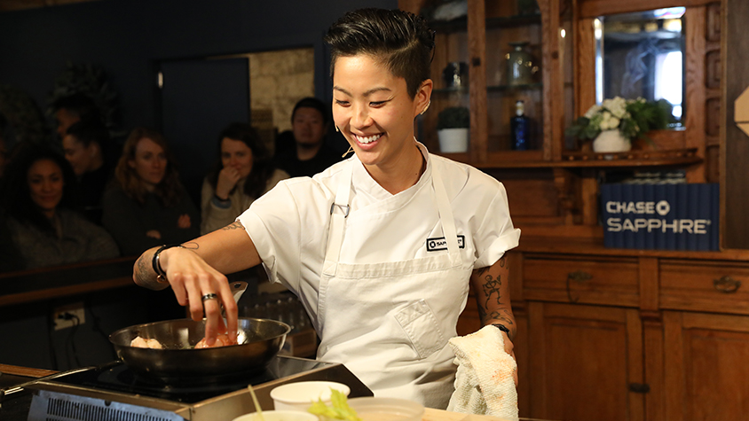 Chef Kristin Kish cooks in a saucepan at the 2018 Sundance Film Festival.