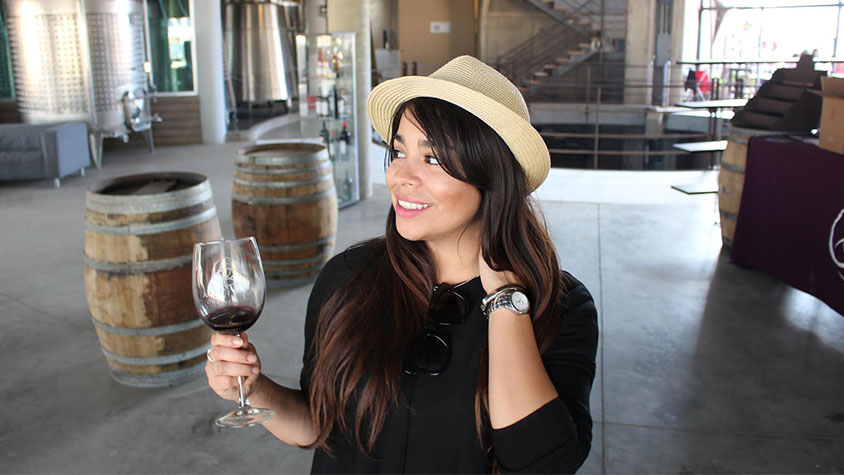 Vanessa Diaz , a resident of California, is shown drinking a glass of wine inside a bar.