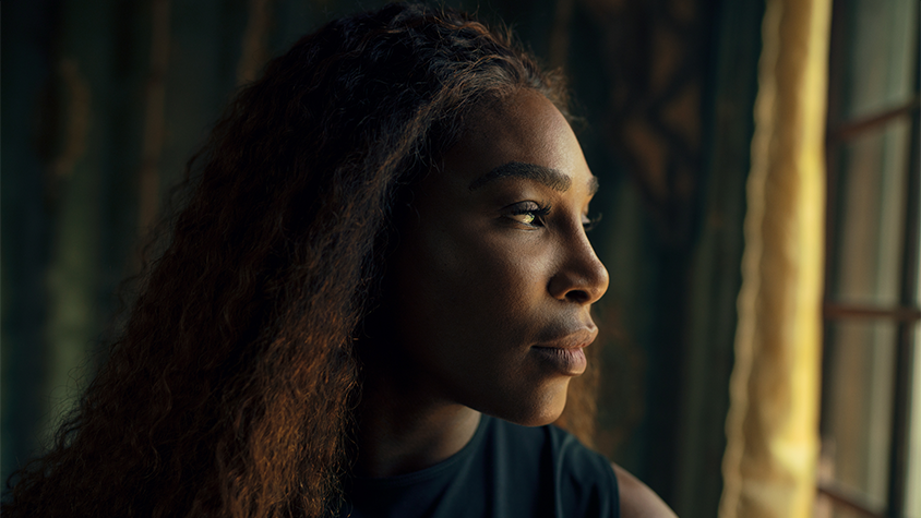 Closeup of tennis player Serena Williams looking out a window.