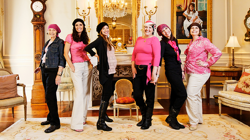 Six women modeling their Chemo Beanies