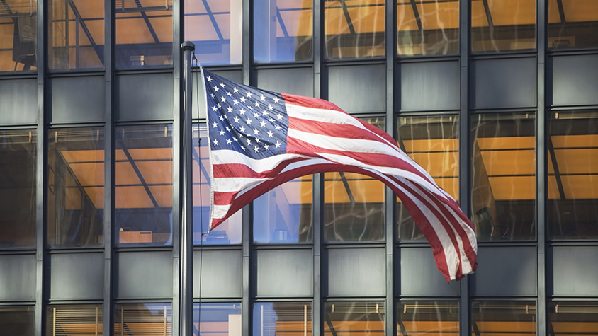 American flag in front of an office building