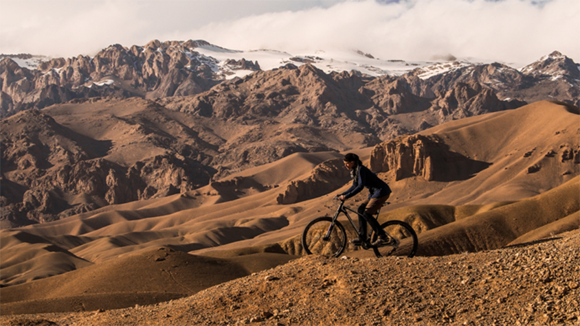 Woman cycling in the mountains